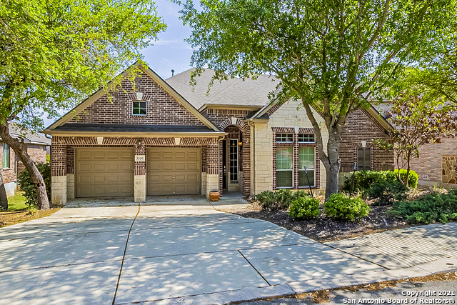 This San Antonio two-story home offers granite countertops and a two-car garage.