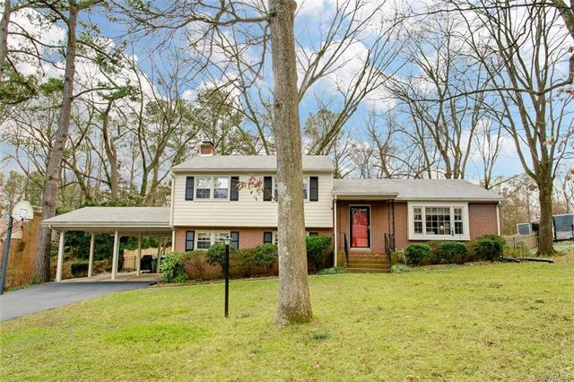 PRISTINE, IMMACULATE AND MOVE-IN READY mid century tri-level in lovely Stratford Hills. Park-like se
