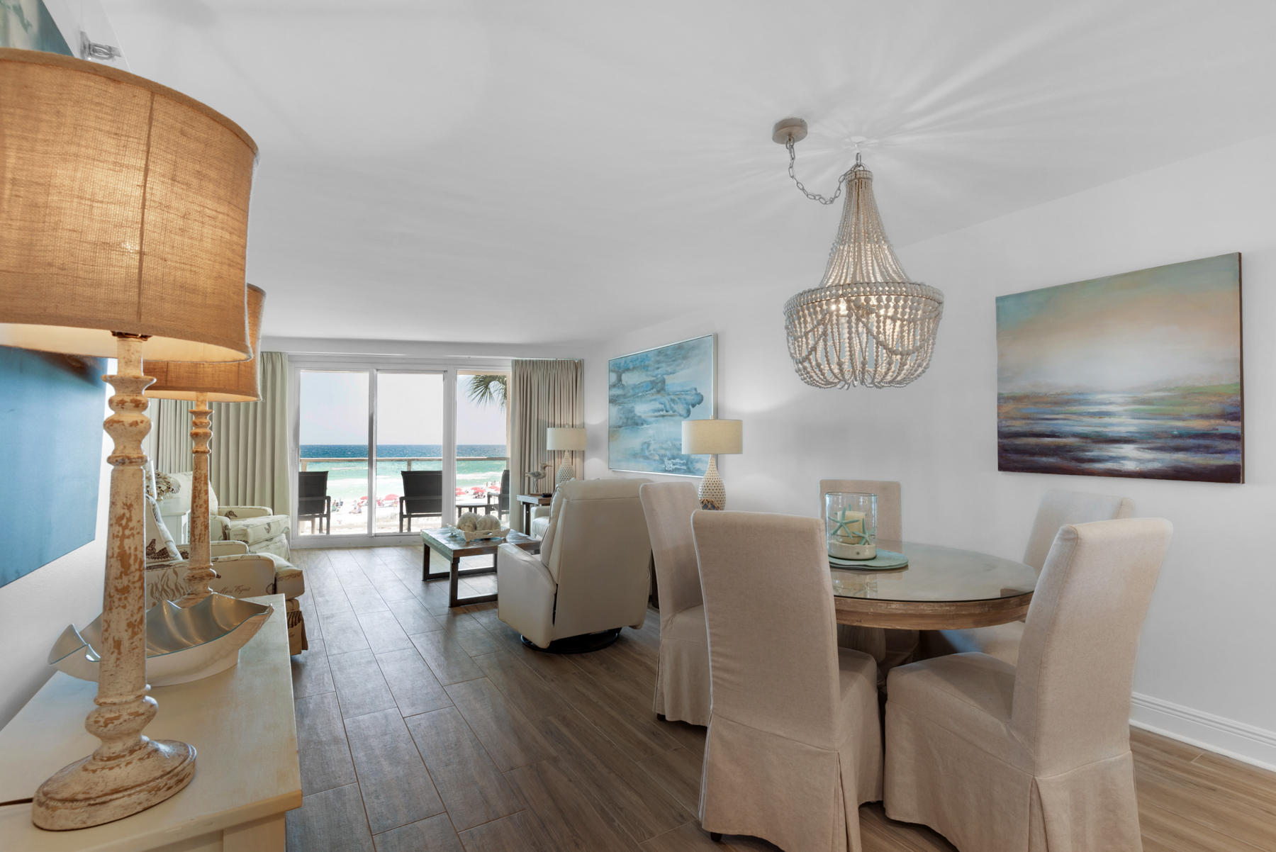 Move-in or rental-ready renovated beachfront condominium with on-trend coastal interiors, covered pa