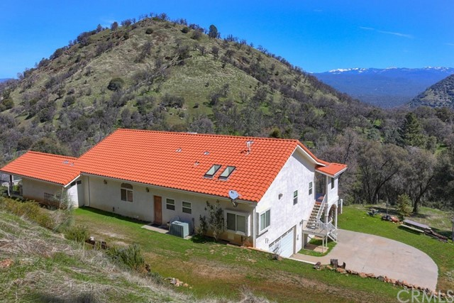Totally outrageously beautiful home with a guest house on 18+ stunning acres!  The 4,400+/- sq. ft. main house will make your dreams come true with 4 bedrooms, 3 1/2 baths with beautiful view windows, living room, family room with bar area, bonus room with private bath, fantastic kitchen and huge laundry.  But the master bedroom is a true retreat with a private patio, walk-in closet, spa tub, shower and sitting area/vanity.  Enjoy the views from the multiple patios!  If this lovely main home isn't enough, the guest house is 2 bedrooms, 2 baths and 834+/- sq. ft.  It's a country charmer!  The guest house is just as beautiful as the main house with a great patio area and private yard.  Each home has breathtaking tree and mountain views!  These 2 homes and property are the perfect retreat!  Feel like you are on vacation year 'round here! MOTIVATED SELLER!