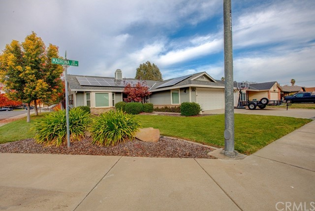 This one is beautiful and efficient. Fully paid for solar system, New Windows installed June 2018. 6 ceiling fans, tile kitchen counters with full tile backsplash. It's also has tile kitchen floors, and tons of storage. Additionally it has cathedral ceilings, carpet and lament flooring, indoor laundry, and 2 bay windows. 3 spacious bedrooms, 2 baths and 1737 square feet of living space. Outside includes a covered patio, dog run, 12 x 16 foot shed all situated on a 7336 square foot corner lot.