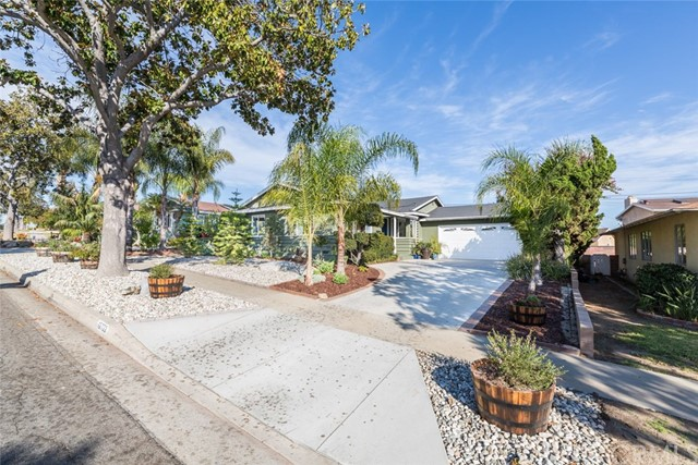 Wonderful home in the popular Gardenhill Area near Biola University. Great curb appeal with a very appealing front yard displaying drought resistant landscaping. When you enter the home it has a warmth to it due to abundance natural light and hardwood floors. Open kitchen with tile floors and tile counters. Hallway bathroom was remodeled within the last 3 years and the master bathroom was remodeled within the last year. All the bedrooms have overhead fans. Spacious backyard with several fruit trees; Lemon, Orange, two Avocdo and a Fig. There is even a tree house. Sewer line has been replaced to the street which is a big upgrade on an older home. There is also mostly copper plumbing throughout the house. Close to award winning Gardenhill Elementary School.
