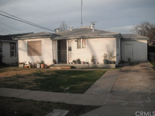 Affordable 2 bedroom / 1 bath home in N. E. Merced. Nice size living room, dining room, and extra room for an office. Attached building could possibly be altered for a 1 car garage, mostly dual pane windows, wall furnace, AC unit, refrigerator stays, large lot, fenced and a storage unit in backyard.  Seller says sell now.  NEW PRICE!!!  JUST REDUCED!!!   $140,000.