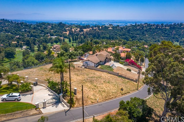 Welcome to Rural Living! Nestled on top of a hillside in La Habra Heights, this spectacular lot offers panoramic view of Catalina Island, Hacienda Golf Course, the hills of La Habra Heights & Palos Verdes and spectator vistas of Orange County. This is the perfect site to build your ultimate custom dream home. This lot offers an escape from busy city life with its serene & country-like surroundings, yet it is close to major freeways, as well as numerous golf courses like Hacienda & Friendly Hills, shops, malls & restaurants. The site has been weed abated recently. Oil and mineral rights pay quarterly dividends. The city of La Habra Heights has Blue Ribbon-awarded schools & has been voted one of the safest cities in the US with consistently low crime rates. La Habra Heights, located just 25 miles southeast of downtown LA, is a picturesque community comprised of hillside estates, grasslands, oak woodlands, avocado & citrus groves, riding trails & panoramic views. Without a doubt, this rural and secluded community has become one of the most beautiful and desirable home site areas in Los Angeles County. Its natural beauty at the start provided an ideal setting for this, but great credit