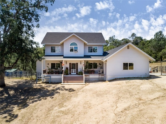 """Come & see this beautiful 37.78+/- acre horse property located in the exclusive """"Flying-O Ranch"""" in the Eastern Madera County foothills of the Central Valley. The home is a 2-story, 3 BD/2.5 BA w/an over sized garage & work room. It has a beautiful Trex deck in the front & back of the home to sit & enjoy the surrounding beauty & natural wildlife. The property has a barn w/2 stalls & a 3rd feeding area. There is an enclosed tack room, feed room, & a small corral is set up at the barn. A mare motel adds an additional covered area for shade & feeding. The property has 7-8 acres fenced & open for grazing. There is an arena w/water/electricity set up, a covered storage area for hay near the main barn, & a storage building for riding equipment. There are 2 separate areas leveled off to set up a round pen & an obstacle course. The """"Flying O Ranch"""" private Community offers 1000+/- acres of riding & trails right outside the private property gate. Yosemite, Bass Lake, Sequoia National Park, & Badger Pass are all within a short drive."""