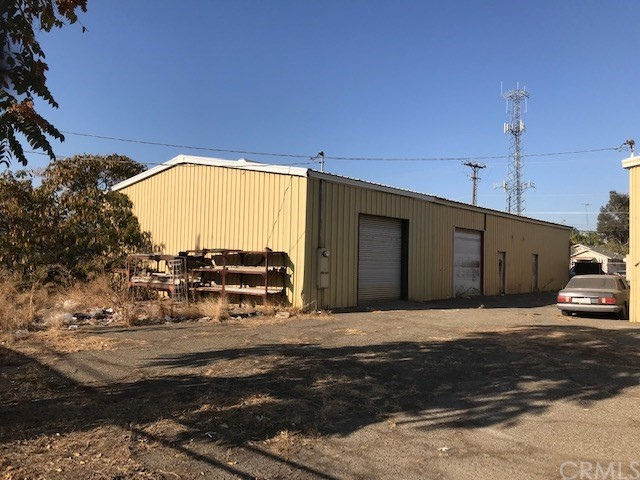 This 4,154 SF metal bldg has offices in front half of the building and the back half is shop space with two roll-up doors for vehicle and equipment access. Zoned C-G General Commercial and ideal for contractor's yard, upholestry shop, auto repair, body shop etc.  Also have abutting to and directly west of this property a vacant lot that is fully fenced and can be purchased as well ( Listing #  mc20113069). The vacant lot is 75' x 200' and also zoned C-G