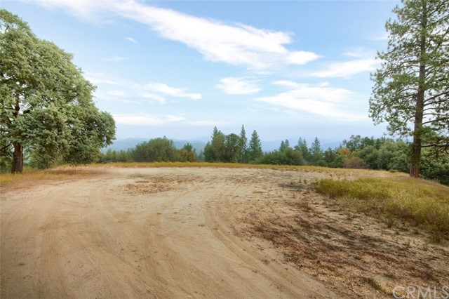 Panoramic views! 3.75 +/- acres with views of the Sierras just above the town of Oakhurst. A large pad is ready for your dream home with area remaining for a large shop. Sewer is paid and on standby. Water is on the property.  Electric is at street. Very private area with easy access to Highway 41.  Roads are paved to the property. Close to shopping, banking, restaurants just minutes to Bass Lake & Yosemite National Park.