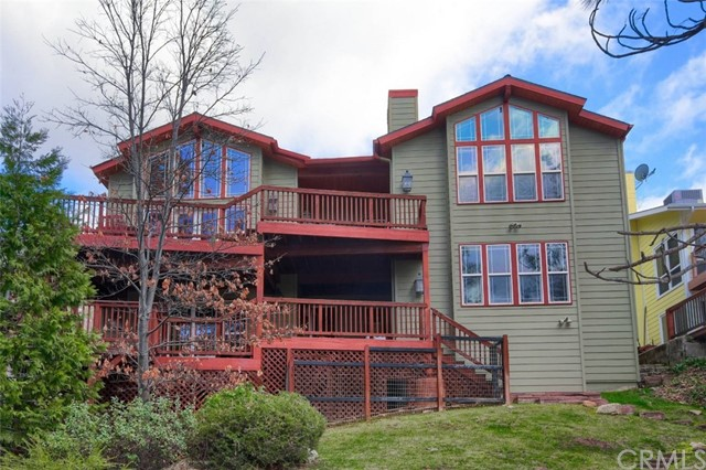 A perfect lake front custom home awaits you here with a great boat slip on Marina View dock! This unique floor plan offers 3 stories with lots of windows and multiple deck levels to enjoy the year round lake views!   The main level leads you to the great room with rock fireplace, dining area with wonderful chandelier, open kitchen with island/breakfast bar, slate floors and surrounded by view windows and beautiful ceilings! Fantastic game/family room with built-in entertainment center and full wet bar. A true master treat where you can wake up to lake views with fireplace, built-ins, huge walk-in closet and a large bathroom with 2 separate sink areas, shower and jetted soaking tub.  From the 2 levels of decking you can enjoy outdoor entertaining with tall trees and lake views!  The backyard offers a matching deck path down to the shore!  There are so many features including owned solar for energy savings!  Start your vacation any time with this wonderful Bass Lake home that is close to Yosemite and would be a great vacation rental!