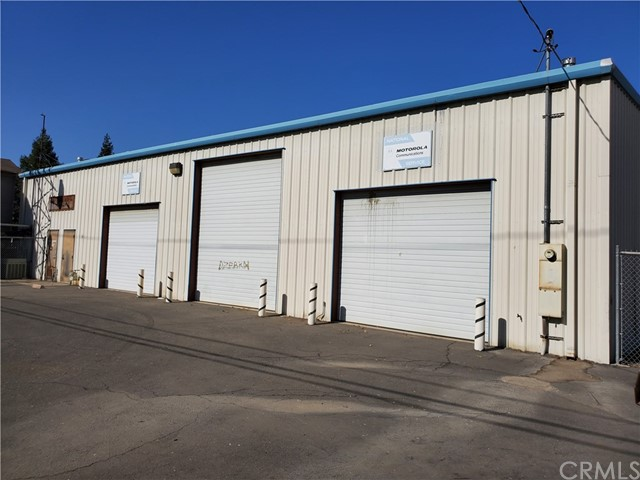 The property features 2 offices, break room, 2 restrooms, work station room, 3 large roll up doors at rear of building. Mezzanine wraps around north and west sides of building for additional storage area.