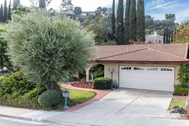 Great location for this lovely home on the West side of Hacienda Heights near the hills. Large lot, 13280 sq ft, and the spacious backyard with patio area and lawn offers a picturesque private area, great for hanging out with family or friends. There is also covered RV parking on the side of the house off the second driveway. Nice view from the front of the house. Good floorplan highlighted by a large open kitchen that has beautiful cabinets, tile counters, vinyl floors, recessed lighting and an island. Lots of cabinet and counter space. There is also room off the kitchen for dining. All the rooms are good size and have been recently painted and carpeted. The master bedroom has a walk-in closet and master bathroom. There is also an inside laundry room that opens to the attached garage. This home is a great value!