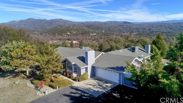 Fantastic Views!!! Absolutely ready for you and your family. This peaceful 2,563+/- sq. ft. home sits on 6.67+/- acres. Built in 1994 and meticulously cared for with 3 good size bedrooms, 2 bathrooms, vaulted ceilings in formal living room with additional wood stove plus a very large 25x35  family room with free standing woodstove. Sale includes pool table, perfect for entertaining. Large open floor plan. Kitchen is spacious with gas range, microwave, double sink, and breakfast bar. Walk out to the back patio to enjoy the surrounding views. Plenty of storage throughout the home. 2 AC/Heating units (only 2 years old), ceiling fans in most rooms, 9KW whole house generator with separate fuel supply, good private well with 2,000 gallon storage tank, not only a spa but a sauna too, and gas BBQ as well. Roof is approximately 5 years old. Did  I mention the views and the privacy this home has to offer?