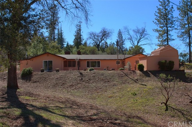 "Wonderful remodeled 1689+/- sq. ft. home sitting back on 1.41+/- acres with fruit trees, along with lots of pines, oaks and cedars.  The front has over 500 irises in the terraced yard to view when in bloom.  Also has a fenced garden in the back.  Large outdoor patio with 2 car garage and separate/storage building plus 2 RV water and electrical hookups!  This 3 bedroom, 2 bath home has an open floor plan with large kitchen and granite counters, pull out drawers and lots of cabinets, 2 pantries and plenty of space to entertain from.  One of the bedrooms has a built-in Murphy bed.  New comp roof and rain gutters.  New heat/AC unit.  New exterior paint, new hardy plank siding, back yard raised gates, new window coverings, Casablanca programmable fan/light fixture. All new bathroom with granite counters.  The master bedroom has a large walk-in tile shower and separate jetted tub.  New ""owned"" solar.  This won't last long!"