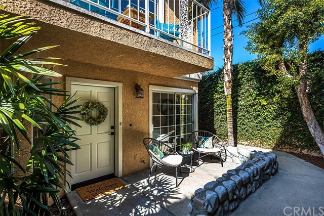 NEW, NEW, NEW is this modern industrial style Friendly Hills area condo. Walk into this completely remodeled condo onto the wood-like LVP flooring and into the light & bright living room that features a tile faced fireplace with reclaimed wood mantle, recessed LED lighting and dining area. The galley style kitchen boasts new cabinetry, quartz counter tops, new stainless steel appliances including the fridge, under-counter and recessed LED lighting too. Finishing off the downstairs in the remodeled half bath. Take the beautiful wood & metal staircase upstairs. there you will find the large master suite. It features a good size walk in closet, private balcony and completely remodeled ensuite bathroom with dual sink vanity and custom tiled all glass surround shower. The two auxiliary bedrooms are also comfortable in size with walk-in closets, new carpet and vaulted ceilings plus the adjacent full bathroom has custom tiled walls with new vanity and new fixtures.  Central air & heat are controlled by a New Google Nest thermostat and there's a NEW water heater. Secure gated complex and direct entry garage includes washer and dryer hook ups too.  This end unit has only one adjoining wall