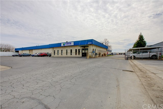 Located on 4.9 acres! This 60,000 steal building has numerous features some of which are: 16 Foot ceiling, three-phase power, Four roll-up doors, one truck dock, ample off-street parking, approximately 20,000 sq. ft. of office space, a fenced lot, upgraded electrical system throughout, and ample bathrooms.