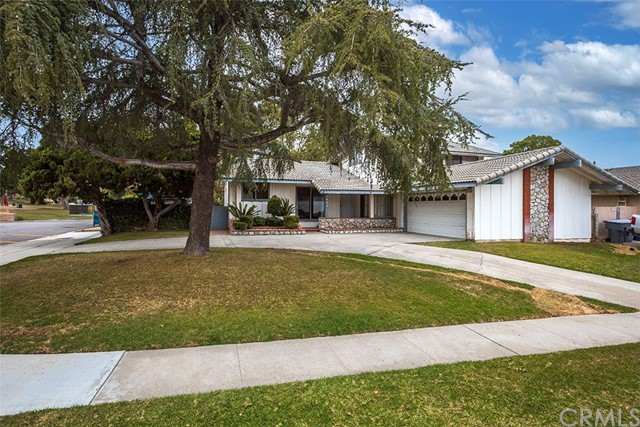 This Classic 1960's home is perfect for your family with hard to find 5 bedrooms and two are downstairs!  The home is located on a large corner lot next to Oeste Park in the highly sought after Fullerton Union & Olita Elementary school district. Enter the home to see the vaulted ceiling living room and huge family kitchen that features a large bay window overlooking the front yard and upgraded kitchen with lots of granite counter space, tons of cabinets and built-in appliances including a new dishwasher and trash compactor.  The living room has a formal dining room and a retro-style angled fireplace and huge windows to see the large backyard. Step down to the massive family room with backyard access and a mini wet bar, perfect for large gatherings. Just off the family room is a updated three quarter bath and two downstairs bedrooms and access to the garage. The upstairs features a large master suite with a attached bath with custom tile work and multiple closets plus enjoy your private balcony with a peaceful park view. Two additional bedrooms and a completely remodeled bath with subway tile finish off the upstairs. Brand NEW main sewer, NEW water heater,  tile roof and copper plum
