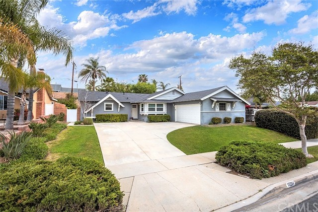 This 4 BEDROOM home is located in a highly desireable neighborhood close to Biola University and offers, a remodeled kitchen with popular white shaker cabinets, beautiful granite counters, recessed lighting, stainless appliances and large stainless sink. The spacious eating area is conveniently located betweeen the kitchen and living room.  Both bathrooms have been updated.  Newer carpet and trendy grey plank-style laminate flooring. Dual paned windows and slider that offers a backyard view from the main living areas. Door from kitchen to backyard has in glass bilnds. Master bedroom and bath with good sized shower. All 4 bedrooms are good sized. Large backyard flows seamlessly from the home and offers a blank slate to make your own outdoor living area, which can be a great setup for entertaining. All this and great curb appeal! ROOMS  AND PATIO ARE VIRTUALLY STAGED.