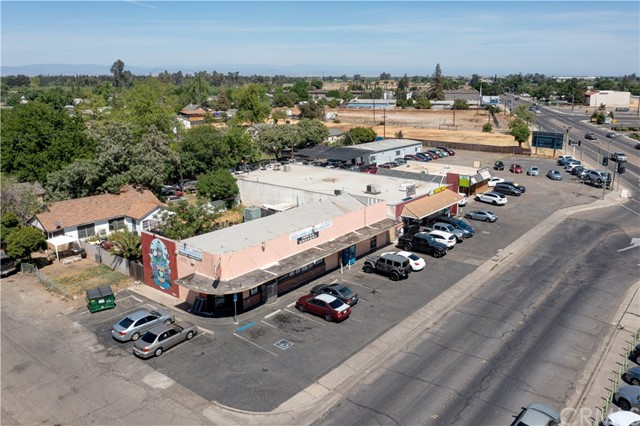 Fantastic investment/development opportunity in Merced! This listing is for two parcels on a corner lot where E.21st St. meets Yosemite Parkway aka Hwy 140 which is the route to Yosemite National Park.  High traffic area! The property being offered is roughly 45,000 sq.ft. and consists of 3 buildings and a large lot.  All three buildings are currently in operation and are generating income for the owner.