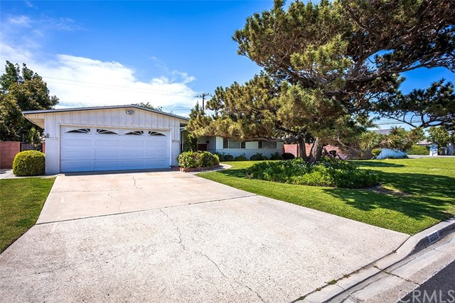 This 4 bedroom, 2 bath home in Garden Grove is ready for some love and attention.  Upgrading is needed, but this is quite a property.  Start with the entry area from the front door into the large living room with fireplace; large sliders in the living room lead you into the unbelievably beautiful back yard -- perfect for entertaining; dining area off living room with lighting fixture; kitchen with additional eating area with lighting fixture; kitchen includes the stove, oven, dishwasher; master bedroom suite; central air; automatic sprinklers in the front and back; direct garage access with laundry hookups.  Looking for a buyer to make this home their own.