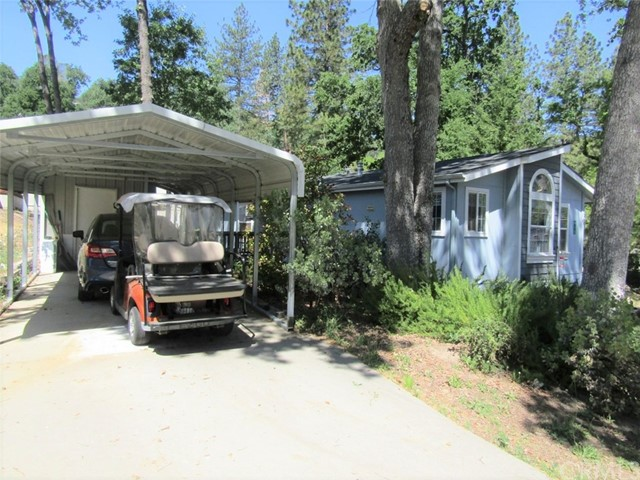 Very nice 3 bedroom, 2 bathroom manufactured home with 2x6 construction in the 55+ community at The Grove with trees, breezes and peek a boo views.  Formal dining room, large kitchen with an island, corner sink and upgraded appliances.  Breakfast nook.  Large pantry and lots of storage and counter space. Master bathroom has a jetted tub and separate shower.  Solar tubes in master closet, kitchen and hall. Custom fans and blinds throughout.  Includes a whole house generator that comes on when the power goes out.  8x10 shed.  2 car carport and awning to side door.  This home is wheel chair accessible.  A customized lovely home in a beautiful area!