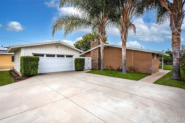 This 3 bedroom, 2 bath open and airy Anaheim home is ready for move in.  This pool home had been updated and all updates still show beautifully.  Features include: granite countertops and custom backsplash in the kitchen; kitchen includes dual sinks, stove/oven, dishwasher; large living room with fireplace; bathrooms have custom tile & designer backsplash; separate laundry room; master bedroom suite with mirrored wardrobe doors; flooring is tile, laminate and carpet; dual pane windows; central air; dining area nestled nicely between kitchen and entry; French doors to back yard from living room; 2 car detached garage (cannot enter without seller present); back yard has plenty of room to entertain -- this will not last!