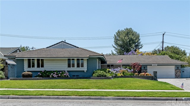 Beautiful curb appeal invites you into a remodeled gem! 3 bedroom, 2.5 bath home that could be a 4 bedroom. Walk up large driveway, perfect for RV, to see the custom brick, stone & paver hardscape, decor & planter, two car detached garage, porte cochere for another car or covered outdoor space. Step up on to the the front porch to the solid wood front door with leaded glass opens into the formal entry. The large living room has a gas or wood burning fireplace, wood like tile floor, scraped ceilings, built-in speakers, two sliders to backyard & recessed lighting. Remodeled kitchen has recessed lighting, tile floor, updated wood cabinets, eating area with ceiling fan, granite counter top, stainless sink, stainless dishwasher, built-in gas 5 burner stovetop with large stainless vent hood, built-in electric oven & microwave. Separate laundry room & remodeled half bath with toilet, vanity & sink. Den/office/dining room could be a 4th bedroom & has area for closet, ceiling fan, new carpet & would need to install one wall or doors to close it off from the living room. Hallway has wood like tile floor & new paint. Updated Hall full guest bath has shower over tub, white tile surround, vanit