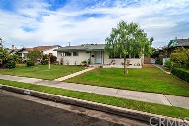 A property like this RARELY hits the market.  This 5 bedroom, 4 bath home is ready for move-in and has been significantly upgraded throughout. This home features: 4 bedrooms, 3 baths in the main house and the garage was converted to its own 1 bedroom (not a separate bedroom, bedroom is part of the living area), 1 bathroom (there is no other garage, but buyer may convert back if desired); copper plumbing throughout most of house (per previous listing, just one bib was not changed to copper); very light and bright open floor plan with dual pane windows (slider in master bedroom is not dual pane); 2018 upgrades include flooring, new dishwasher, interior/exterior paint; new (2019) air conditioner affords you the ability to have 3 different thermostats so you only cool the areas you are occupying; ceiling fans in step down family room (den), dining area, all bedrooms in house & garage conversion; recessed lighting in living room & master bedroom; large, open living room with carpet has wood burning brick fireplace and opens to kitchen/dining area; kitchen includes dishwasher, stove/oven, microwave, granite countertops & backsplash, tile flooring, island separating living room (perfect f