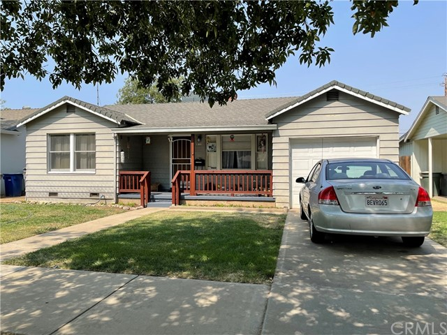 """Tired of getting beat out in this market? Here's a great opportunity for home buyers or investors!  This property is zoned R-1-6 and is already fenced separately for storage, ADU/2nd unit, potential RV parking or huge shop!  Check with the City regarding building restrictions.  Property to be sold with SELLER FINANCING ONLY! House has 2bd/1ba with a huge bonus room, 16'x21'6""""!  Enjoy wood flooring in the living room, hall and bedrooms.  Nice energy efficient fireplace in the living room.  The laundry area is inside the house with it's own separate room.  Tile counters in the kitchen and nice covered front porch.  Call today before it's gone!"""
