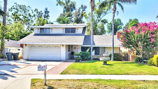 CURB APPEAL IS THE FIRST THING THAT COMES TO MIND WHEN DRIVING BY THIS LOVELY 4-BEDROOM HOUSE WITH A DECORATIVE FOUNTAIN IN THE FRONT YARD, A HUGE FAMILY ROOM, A FORMAL LIVING ROOM WITH FIREPLACE, A KITCHEN WITH A COOKING ISLAND, 3 BEDROOMS UP + 1 BEDROOM DOWN, 2-CAR ATTACHED GARAGE WITH  ROLLUP DOOR, A LARGE BACK YARD BACKS UP TO HILLTOP PARK WITH A NICE WALKING TRAIL, LOVELY VIEW OF THE SAN GABRIEL MOUNTAINS AND CHERRY BLOSSOM IN THE SPRING. THE YARD HAS MANY PALM TREES AND AGAVE PLANTS. BOTH BATHROOMS HAVE BEEN RECENTLY AND EXQUISITELY REMODELED. ALL THE FLOORING IN THE LIVING ROOM, BEDROOMS, AND UPSTAIRS HALLWAY HAVE BEEN UPDATED TO LAMINATE WOOD FLOORING.  Agents, please make sure to read the private remarks.