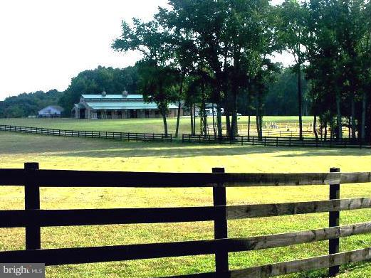 *24 hrs notice..Beautiful 38+ ac horse farm, incls a 56x100 12-stall barn w/tack rm, wash station, office & loft; 34x70 Storage/Wkshop w/r.i.for apt; huge 4-bay machine shed w/storage; exercise & jumping rings; fenced pasture & a lovely 2 BR home w/chef's delight kitchen, hdwd flrs, FP, sunroom, unfin basement, 2 car gar. **Also has 3 add'l percs!   Located in Lexington Park Development District.