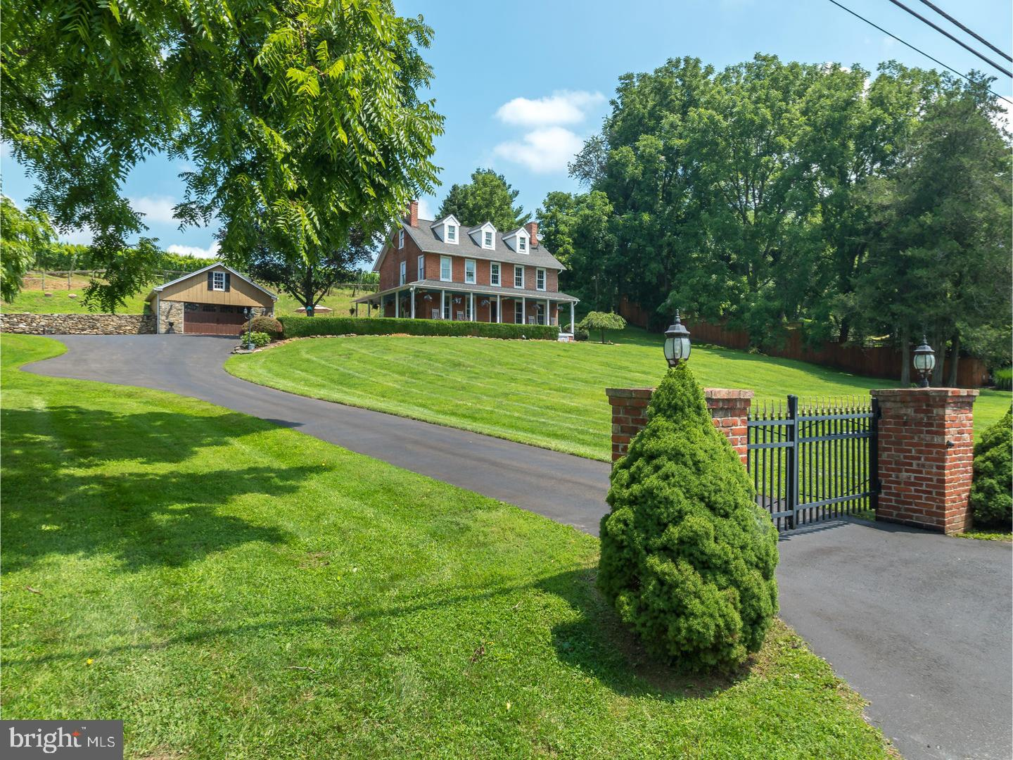 Make your dreams a reality!  Have you ever dreamed of owning a historic home with an income generating farm, even better a vineyard? Now your dreams can be a reality. Nestled in the sloping hills of southwestern Chester County is a beautifully restored 1840's brick federal style farmhouse with wraparound porch, originally a large dairy farm which produced thousands of pounds of butter. The home boasts hardwood floors throughout, 4 fireplaces, large chef kitchen with fireplace, decorative iron-work and slate tile, fully finished basement with full bath. Low maintenance stamped concrete patio, ornamental fish pond, beautifully landscaped, 4 stall bank barn and fenced pastures. Grid tied solar electric system produces almost 40kW of clean electricity supplying over 100 percent of the property's electric needs. Cottage with full summer kitchen and running water sits amongst 10 acres of vinifera wine grapes and with the moderate climate and rolling terrain it provides some of the best growing conditions on the east coast. Two wells for water and invisible dog fencing.