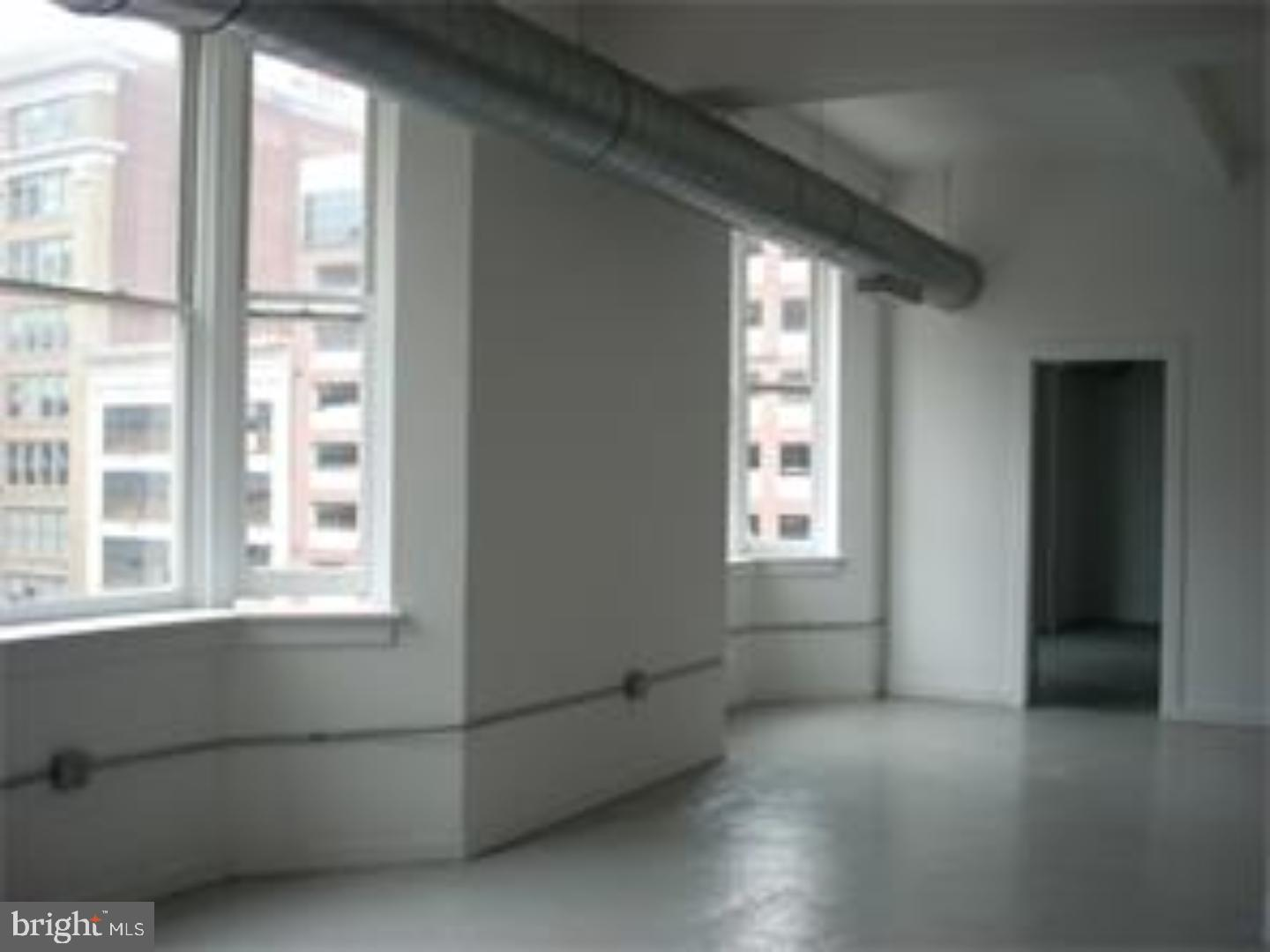 Unique corner NY Style Industrial LOFT located along the Avenue of the Arts with the Exciting N. Broad Street Renaissance of the Divine Lorraine and the Metropolitan Opera House, etc., this large 20x100 Loft is an open canvas for your design ideas. One Loft condo per floor in the Art Deco building at the corner of Broad and Race. 2 Bedrooms and 2 Bathrooms with open kitchen and living space. Features high ceilings, concrete floors, windows on 3 sides filtering in South, East and West light. Great views of City Hall, Convention Center and other architecture and art works that surrounds the building. 99 Walk Score. Close to Restaurants, shopping, Terminal Market and more. Septa, Train, Uber, etc.get around the City.
