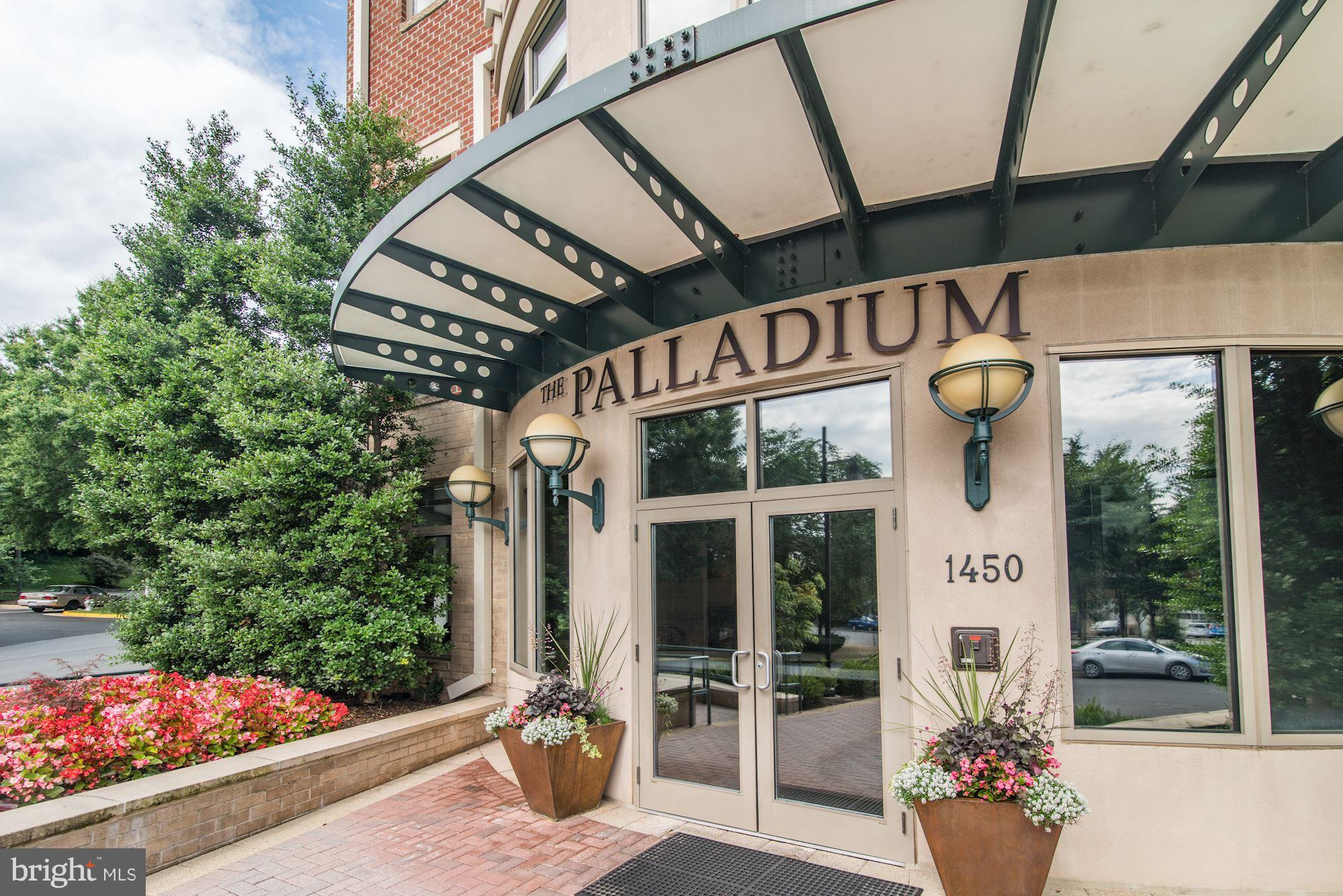 Sought after model! Spacious & bright condo with over 2400 sq ft of beautiful living space. 2 BRs, 2.5 baths, separate dining & living space with den. Unique with 2 patios, and a separate large storage unit. Within walking distance to shops/restaurants and all the conveniences of The Palladium at McLean! Secure two car garage parking, concierge, club room, fitness center, conf.rm, billard, & more!