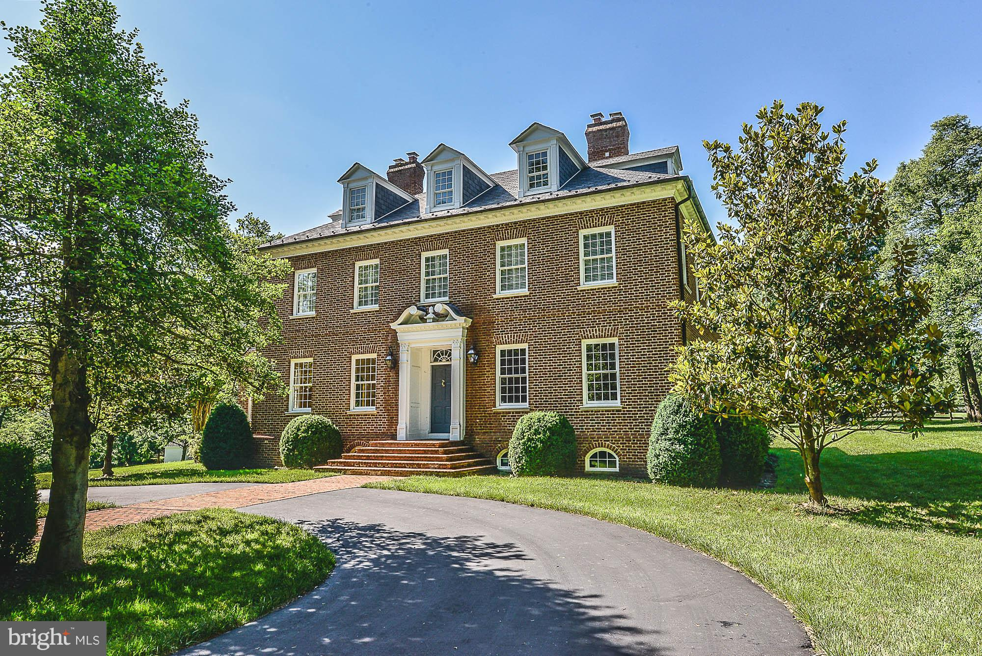 Custom elegance abounds in this authentic Williamsburg-style estate. 5 bedrooms, 4.5 baths, and over