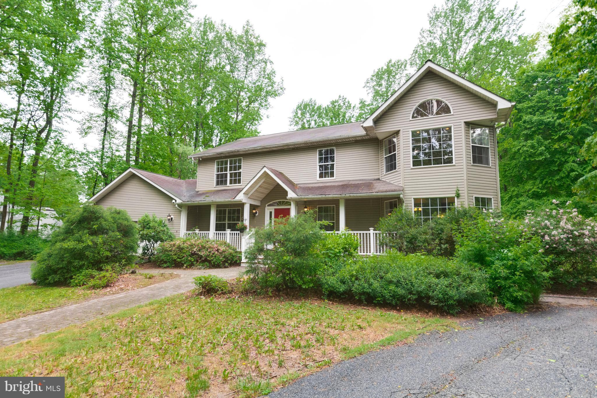 Amazing opportunity! Private wooded acerage w/ stream. Needs cosmetic updates & priced accordingly - make it your own & have instant equity! Huge master w/massive walk-in closet & garden bath, 2nd & 3rd BR each w/walk-in closets. Cedar closet & oversized pantry in bsmt.  Shed looks like a playhouse! 4+ space pkg, 400 amp elec svc, extensive landscape lighting & ext outlets.  Perfect for 203K loan.