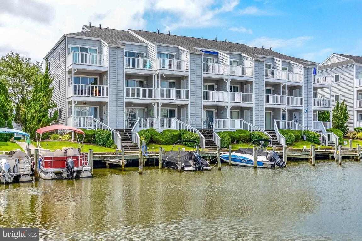 Immaculate 1 bedroom waterfront condo, in a desirable neighborhood. Great location! Only 3 blocks to the beach, steps away from the pool & very close to Northside Park where you can enjoy lots of fun activities. Within the last 5 years, the sellers have replaced the HVAC, all flooring, washer, dryer, dishwasher, bath vanity & garbage disposal. This property is being sold fully furnished and includes a sofa bed. Large private deck with water views and storage shed area for your beach chairs. Common boat slips are available thru the association to rent.