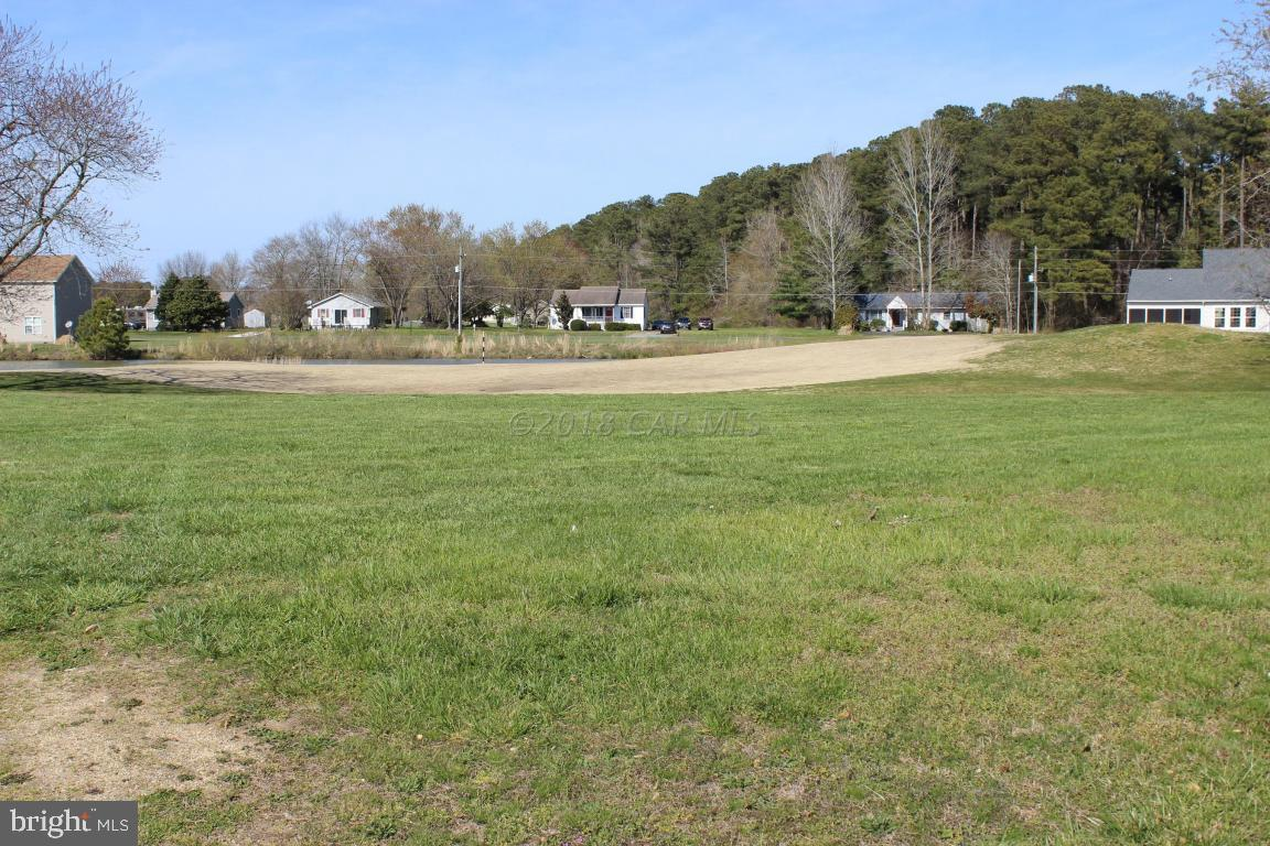 2/365  Cleared cul-de-sac golf course lot overlooking the 3rd Fairway, Green and pond on a pristine golf course. Cert. Letter on file for 3BR, water availability. Buy now at todays low price and use the amenities until you are ready to build.  Location...just a short walk or bike ride to all the amenities Captains Cove has to offer.  Builders ''Price Line Models'' starting at $134,300.  Captains Cove is a waterfront community located on the Eastern Shore of VA nestled on the Chincoteague Bay and close to Chincoteague Island, Wallops Island & Ocean City MD.  HOA dues include FREE golf, indoor/outdoor pools, fitness center, basketball & tennis courts, boat ramp, playground, security and so much more.   Call for more information.