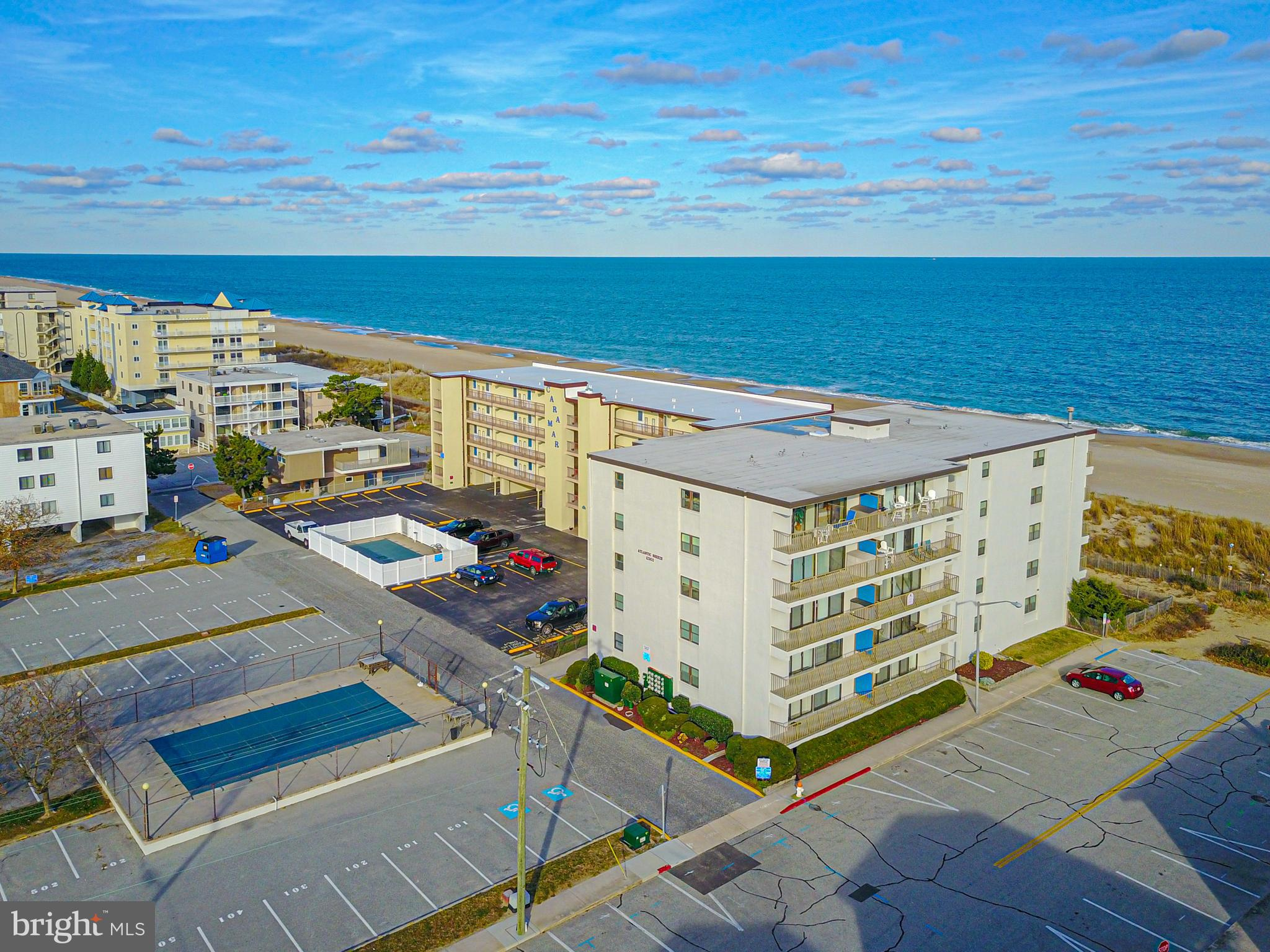 Southern Exposure Condo with Spectacular Ocean Views from your oversized balcony with accessibility from Living room and Master Bedroom.  Masonry building with strong association, Inground Pool, Outside shower, Elevator, Handicapped Ramp, Renovated Kitchen with Island, chair rail, crown molding, tile and more.  Located in clos proximately to Northside Park, Grotto's Pizza, Food Lion, Entertainment and Restaurants.  Plenty of additional parking.  Non-rental but could put in a rental program.  Similar units have Gross Rental Income of 35K per year.