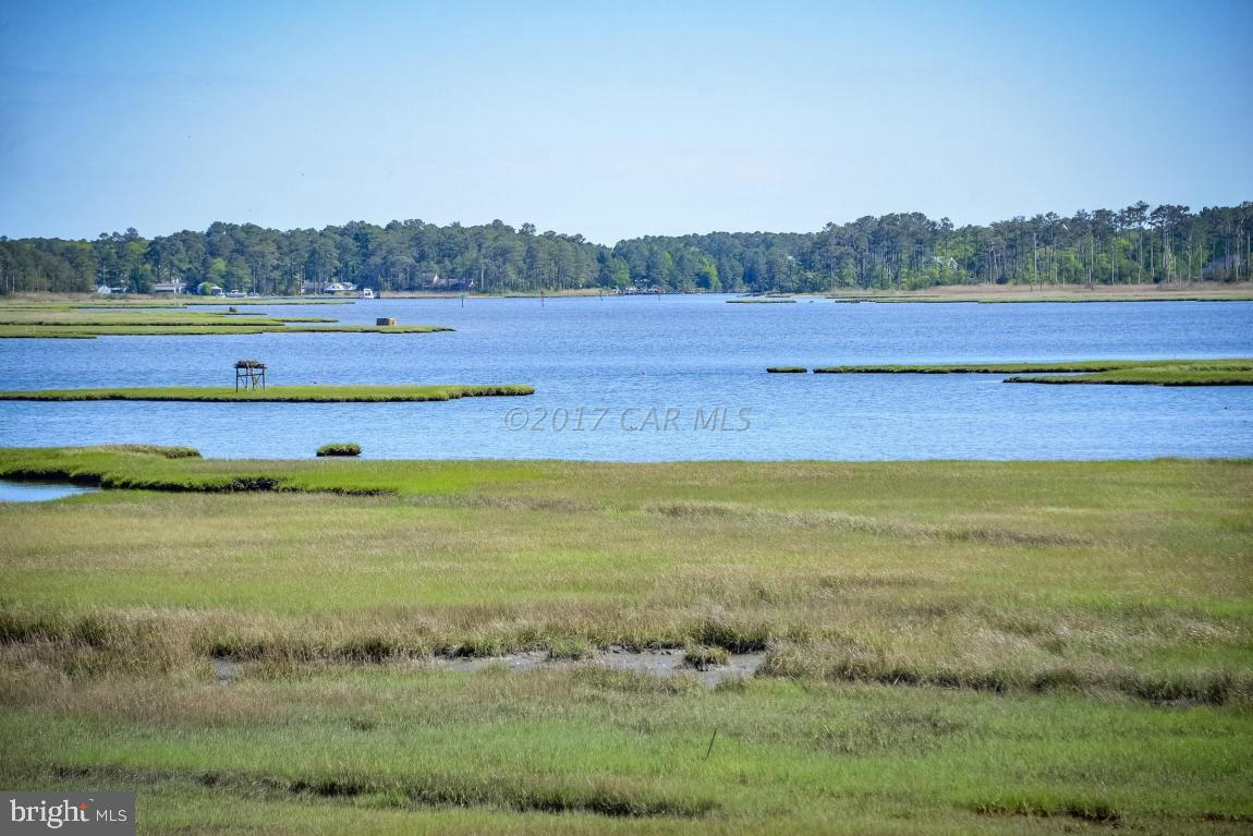 Gorgeous water views of Herring & Turville Creek, from one of the last remaining lots in The Point. You will enjoy the private setting (house can be set back from the road) offered from this oversized lot. There is a large building area and you can choose the Builder of your choice. Great location in one of Ocean Pines nicest neighborhoods. (There is a pathway cleared on the lot which takes you to a clearing, and then you may walk on the property line of 124 Pine Forest Dr). Enjoy all the community has to offer including Yacht Club and restaurant, 4 swimming pools (1 enclosed), Robert Trent Jones golf course, Community Center, Beach Club on the ocean, Boat Ramps and Marinas, community police and fire departments, playgrounds, dog park, skat