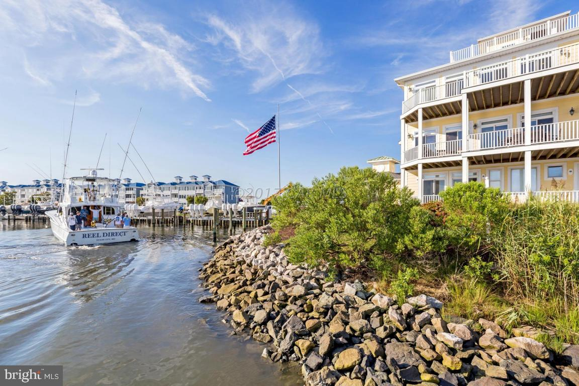Finest Luxury Living-Waterfront expansive coastal home & boat slip for discriminating owner who loves to entertain & wants to live coastal marina lifestyle. 5 bedrooms, den/office & library each w/windows or own balcony overseeing Ocean City/bay/inlet/marshes/docks set stage for amazing views, sunsets, watching boats/yachts. 1st floor guest quarters:4 bed, 3 baths, den, Capt Galley & laundry.Take staircase or elevator up to upgraded kitchen & incredible open-concept great-room w/dining room, sitting area, living room & bar, powder room & laundry w/storage. 2nd floor:master suite w/sitting areas, dressing lounge, gorgeous bath, library w/powder room. Top floor-Crow's Nest overlooking deep water slip. 2-car garage w/storage. Perfect for angle