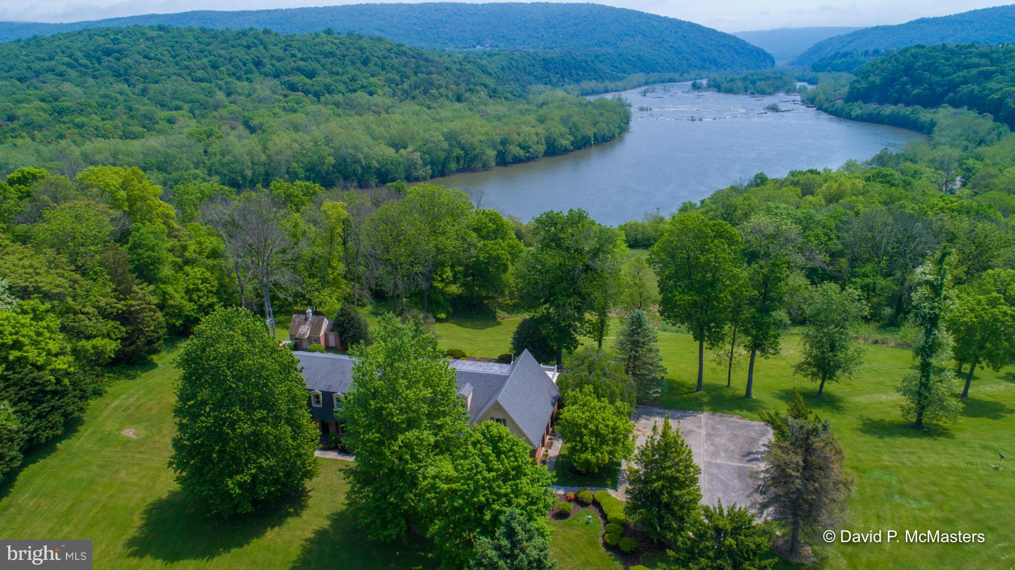ESCAPE  to an astounding view of the HARPERS FERRY GAP and 11 private acres yet convenient and close
