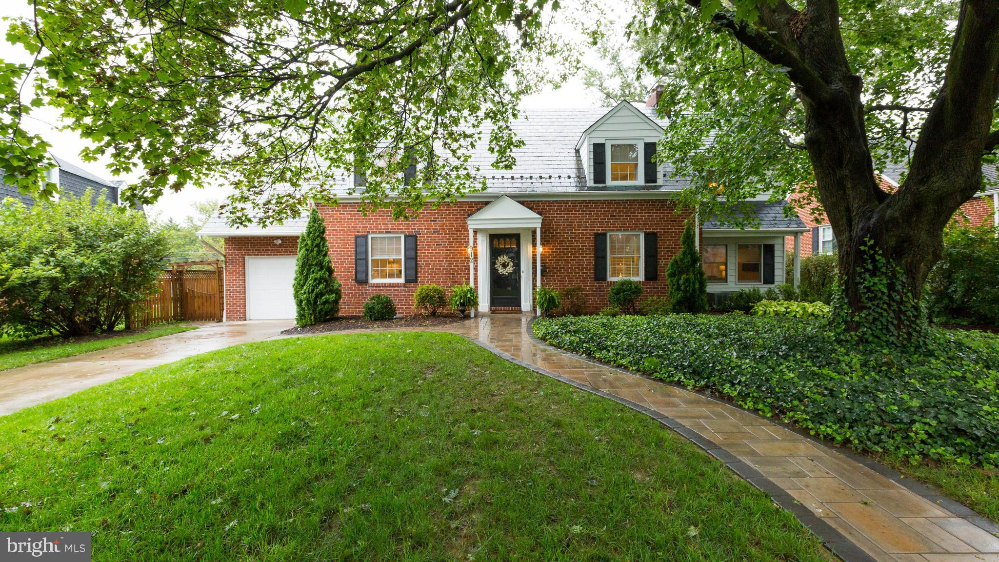 TRULY IMPRESSIVE PROPERTY IN TOWSONS RODGERS FORGE SUMMIT NEIGHBORHD! CLASSIC BRICK/SLATE CAPE W/ALL