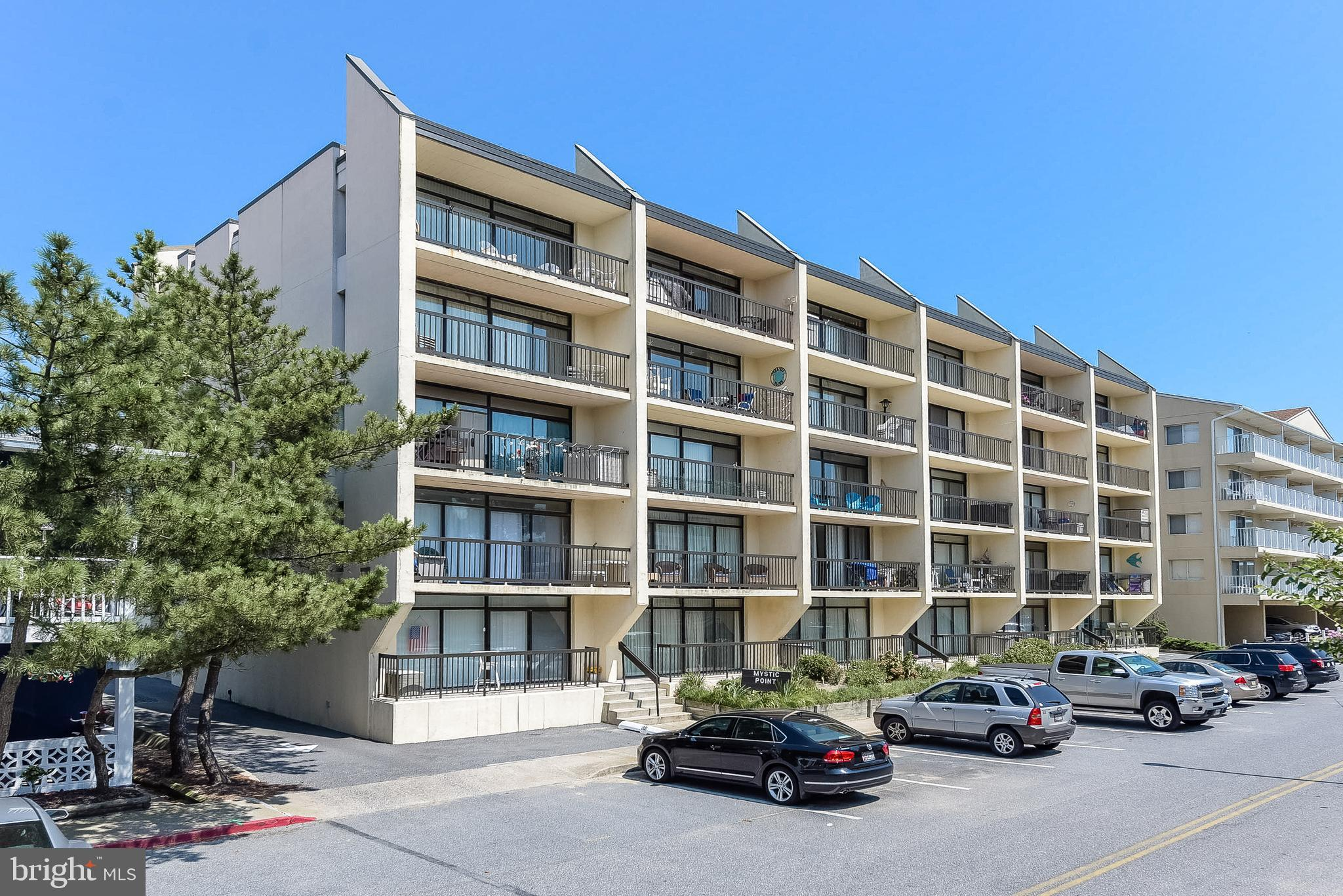 Current contract has 72-hr kick-out so can still be shown. Great Ocean Block 2 bed/2 bath Condo in Masonry Building with an Elevator!  Large living room opens to balcony with views of ocean and southern exposure. New HVAC still under warranty (2018), new bathroom fixtures (2017), flooring (2015), washer/dryer (2013),  electrical outlet/plugs (2017) and newer bathroom updates including toilets, sinks and tubs. Plus recently painted. Excellent location in mid-town, close to so much including the Convention Center. Lots of restaurants, shopping and entertainment just steps away. A low density beach means less crowding. Owner's didn't rent, but could easily be a rental. All this plus low condo fees and strong condo association/management. Don't miss out on owning this as your new beach home!