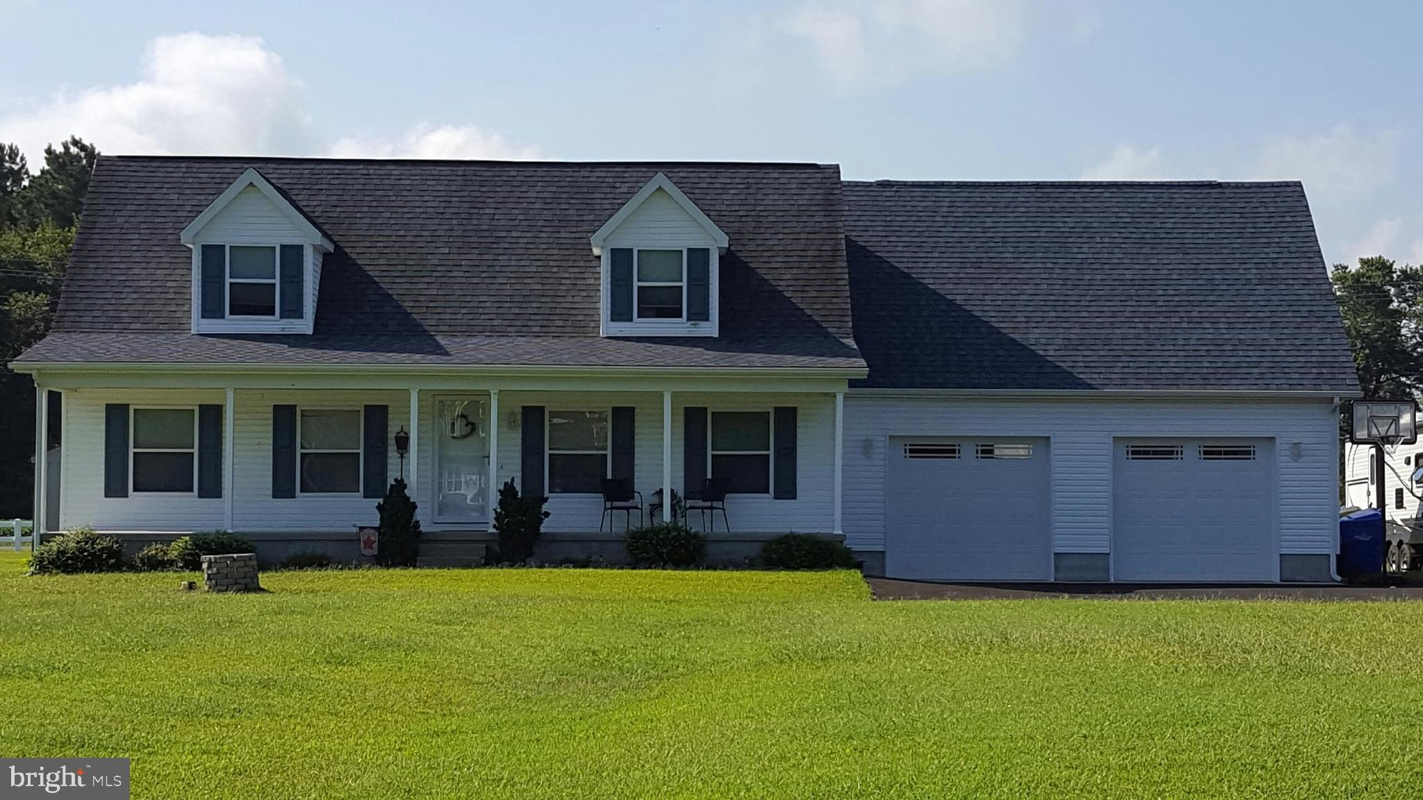 Spacious Cape Cod in a quiet and friendly community.  This home boasts 4 bedrooms and 2 baths, with