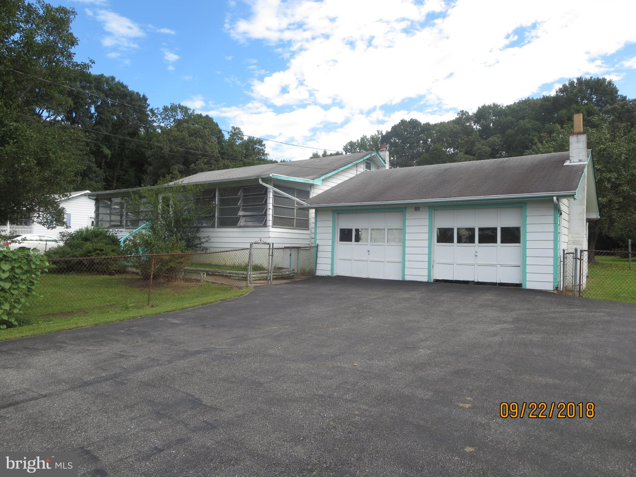 Investor Alert! 3 Bedroom ranch located on .69 Acres with 2 Car Garage and finished basement with wa