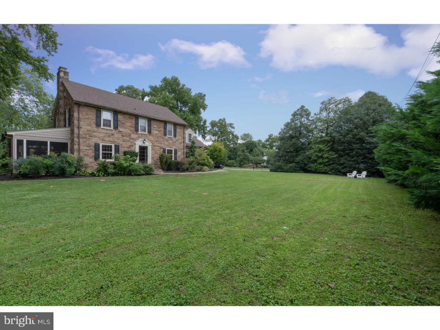 Charming stone colonial loaded with character sited on a private, well landscaped, half acre lot in