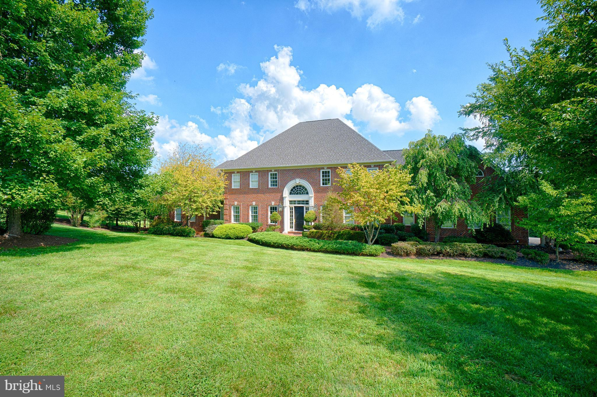 Custom brick Georgian on 4.55 acre estate lot backing to open space.First floor master, library with