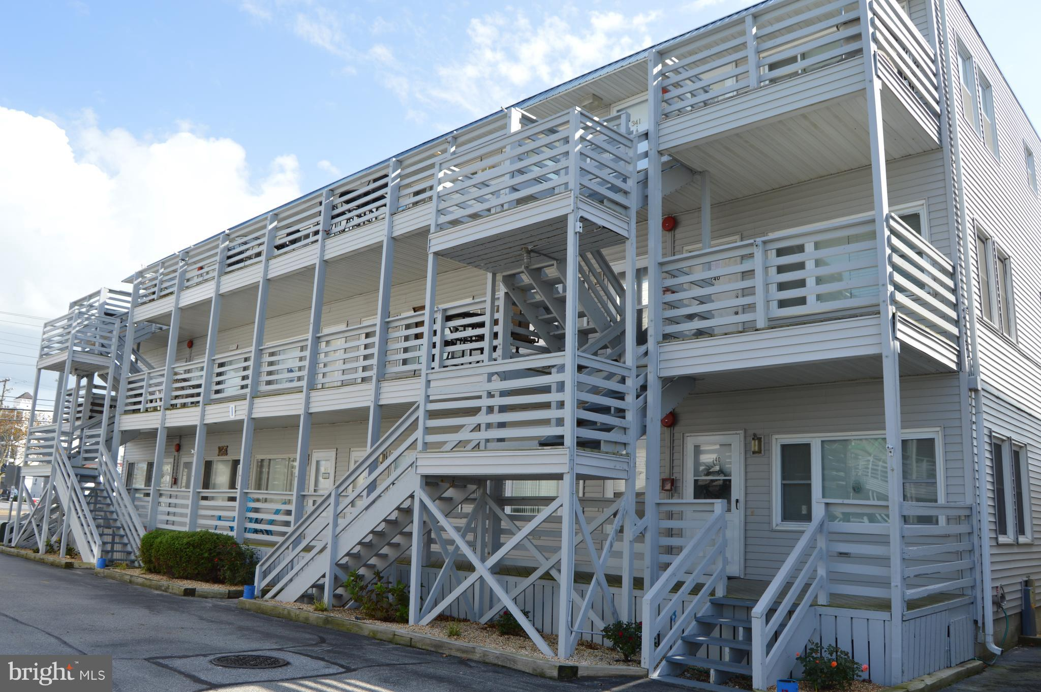 Priced to Sell! Well  maintained,  first floor condo with upgraded flooring and kitchen cabinets.  Bay oriented community  featuring pool, community boat slips, jet ski docking area, sandy beach and boat ramp . Convenient mid-town location. An ideal second home or rental property. Easy walk to beach and Convention Center.  Personal items in closets and two end tables are excluded. Buyer to honor 2019 rentals.