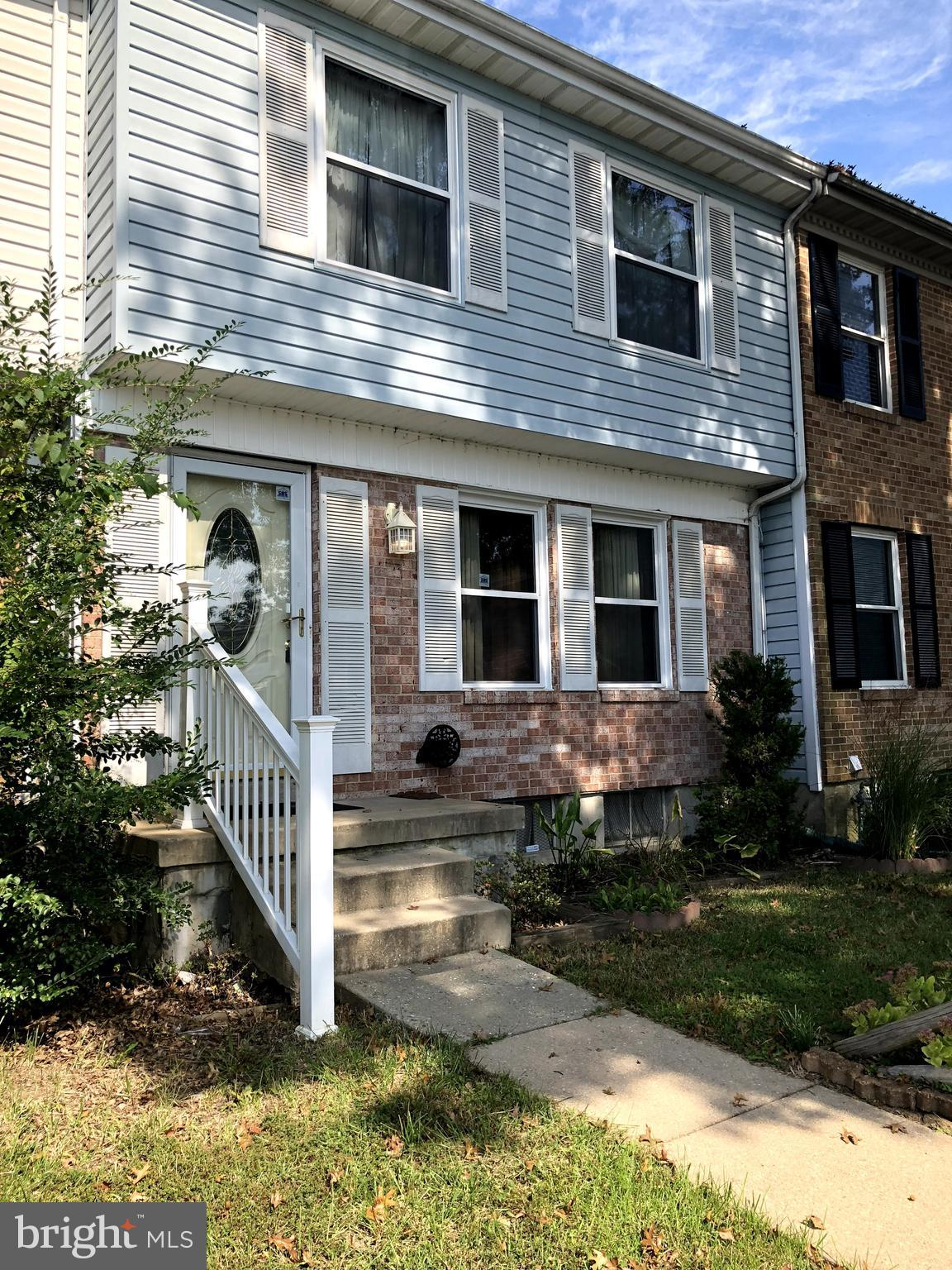 Welcome Home!  This bright townhouse in Harford Square features large eat in kitchen with updated ap