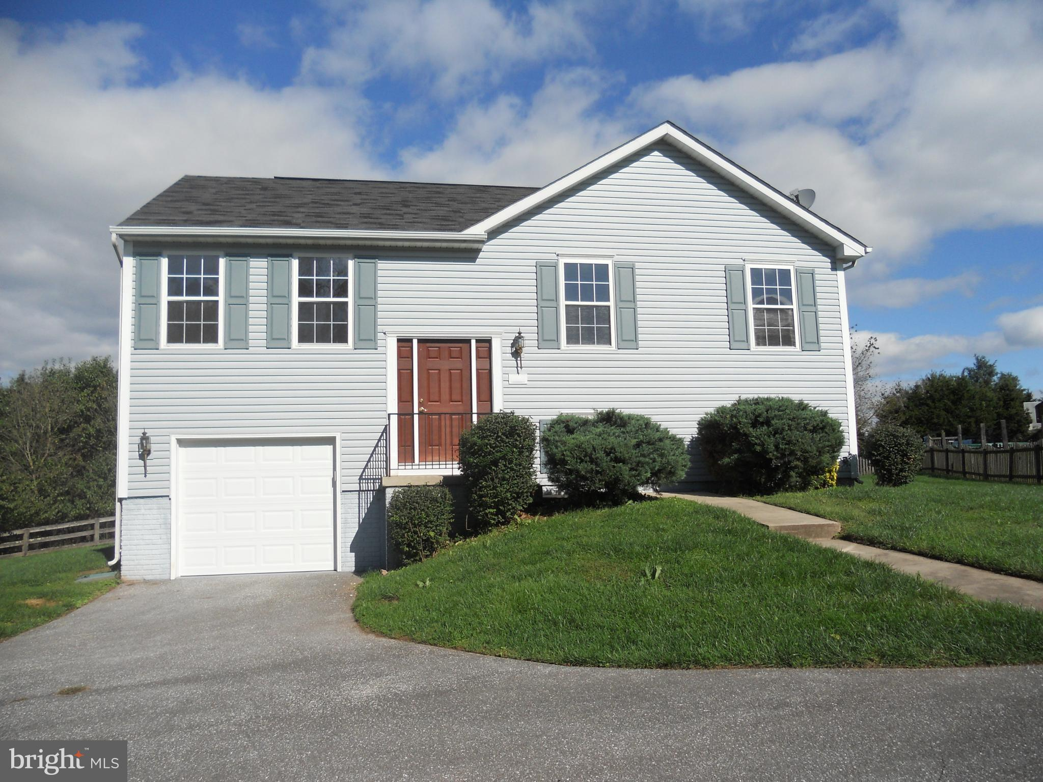 Lovely split foyer with 3 bedrooms and 2 full baths ,eat in kitchen with island and slider, living r