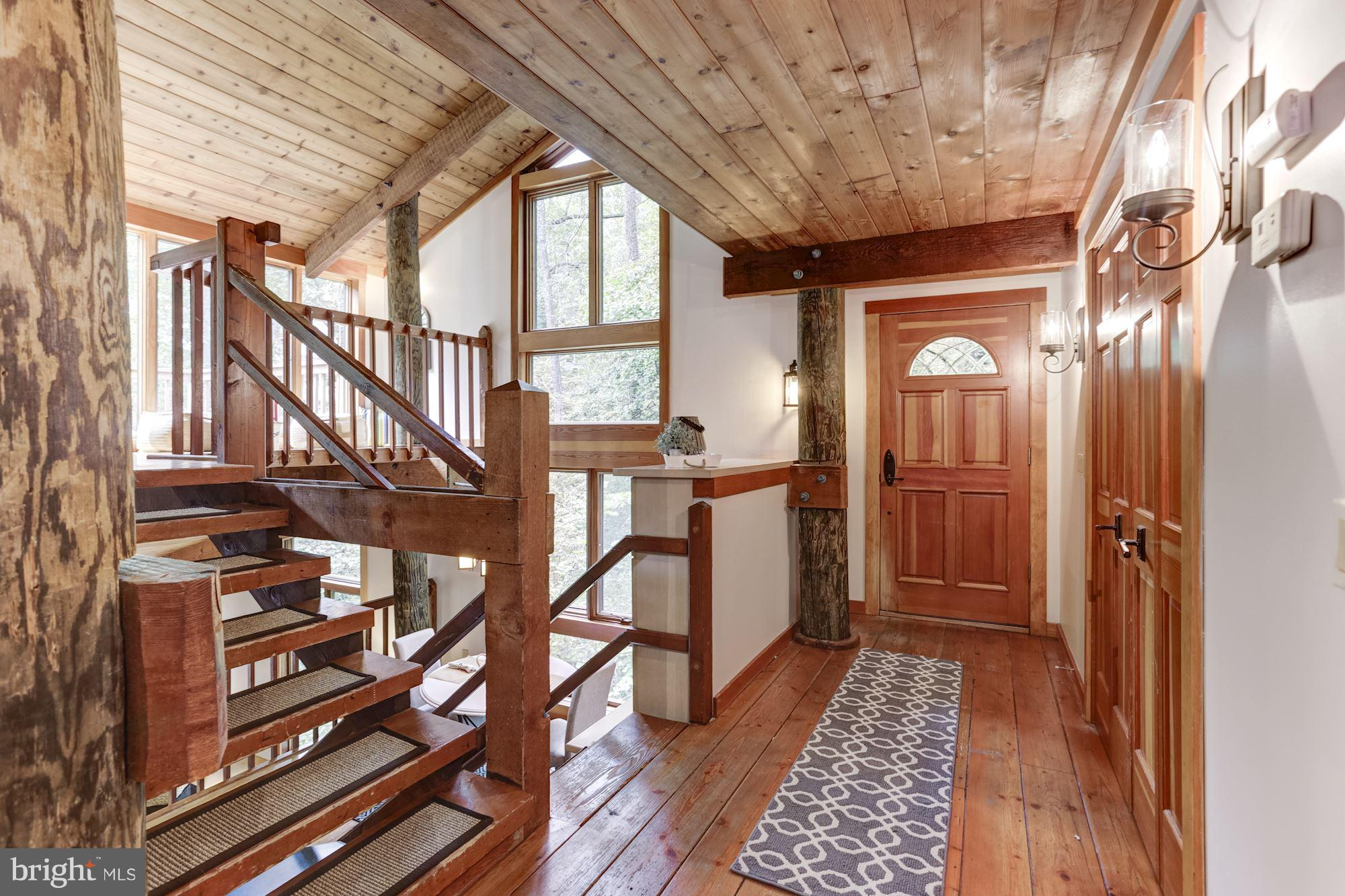 Beautiful custom built treehouse in sought-after Epping Forest. 3-bed/2-bath. Expansive decks with w